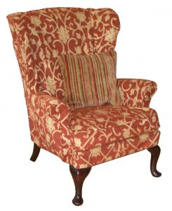 gray wingback chair brown cream fabric back wing chair with floral pattern combined with green brown stripped cushions also four dark brown wooden legs with also