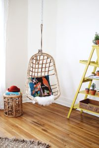 hanging inside chair fantastic design of hanging wicker chair made of rattan material with blue pillow