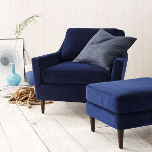 navy blue wingback chair velvet upholstered chair and ottoman in cottage style shiplap room pantone navy peony